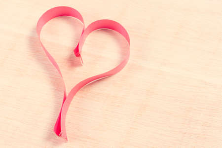 Heart with red ribbon over wooden background Stock Photo