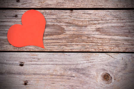 Red paper hearts on wooden background photo