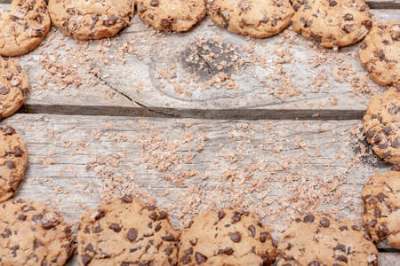 Homemade chocolate chip cookies on wooden background photo