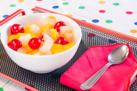 Healthy breakfast fruit salad with different pieces photo