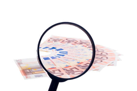 fifty euro banknote: Fifty euro banknote fan through magnifying glass isolated on white background