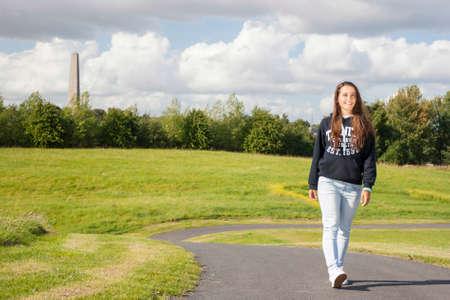 kilmainham: Beautiful teenager having a walk in the park