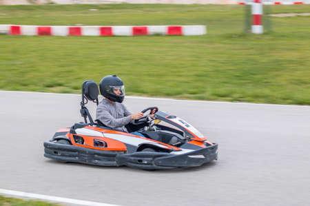 Young man driving a kart in a race 免版税图像
