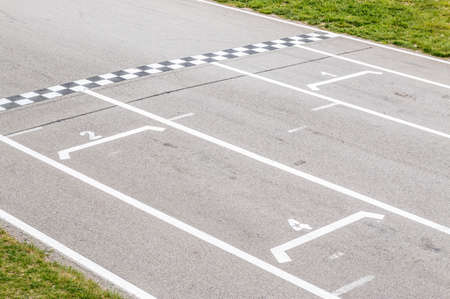 car race: Closeup of finish line in a karting circuit