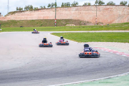 racer: Group of karting racer in a circuit