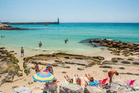 tarifa: TARIFA, SPAIN - JULY 23, 2015 - View of the beach with people sunbathing in Tarifa, Costa de la Luz; Cadiz Province, Andalusia, Spain, Europe, July 23, 2015. Editorial