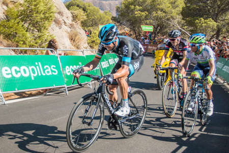 mount tom: Malaga, Spain - August 23, 2015: Johan Chaves (Stages Winner), Tom Dumoulin and Nicolas Roche on their last 500 metres on the Caminito del Rey stage at Tour of Spain in Malaga, Spain on August 23, 2015