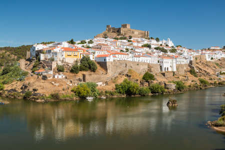 portugal: View of Mertola Town and the Guadiana River on foreground in Alentejo, Portugal