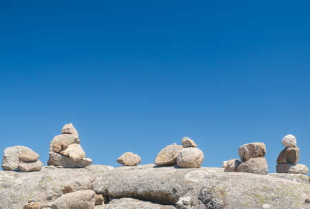 monchique: Stones stack with blue sky background at the Monte Foia in Monchique, Portugal