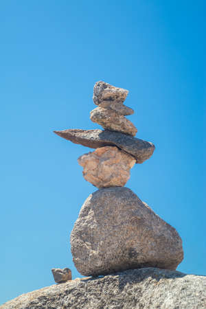 monchique: Stones stack against blue sky at the Monte Foia in Monchique, Portugal