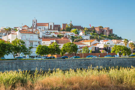 castle buildings: View of Silves Town with the Castle and church on the top in Portugal