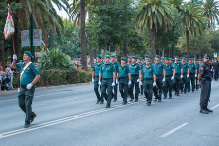 road warrior: Malaga, Spain - October 04, 2015: Policemen (Guardia Civil) marching down the street. Parade in Malaga, Spain on October 04, 2015 Editorial
