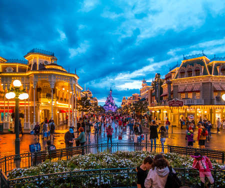 FRANCE, PARIS - Aug 17, 2017: View of people walking on main street towards the Castle in Disneyland Paris, Marne-la-Vallee Chessy in Paris, France on August 17, 2017