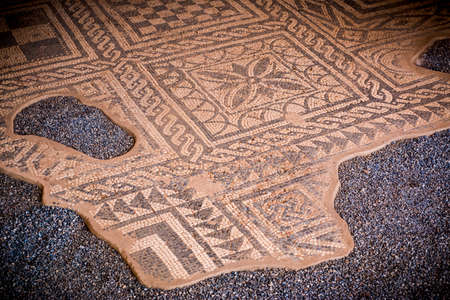 Merida, Spain - Oct 28, 2017: From above texture of old mosaic in the historic roman ruins in Merida, Spain on October 28, 2017