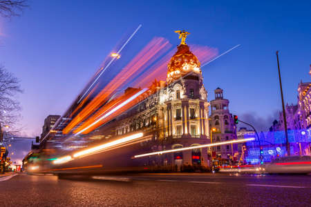 Spanish city, Madrid, in the evening with bright lights and cars movements in long exposure