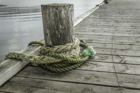 Rope for mooring on an old wooden pier