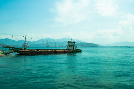 turquoise water: Sea view with old cargo ship Stock Photo