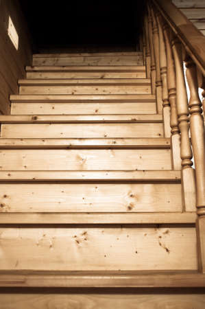 architectural lighting design: Details of rustic wooden staircase front view