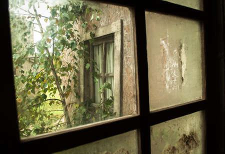 look through window: Look at poor housing through a dirty window