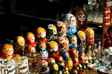 multiple ethnicities: sale of Russian souvenirs -  nesting dolls, mugs and stuff