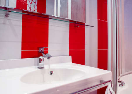 Splashy bathroom interior in red and white colors in modern style