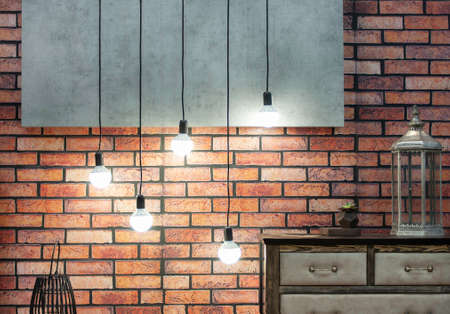 Loft-style interior with orange brick wall and lamps on a long wire frontal perspective frontal perspective Zdjęcie Seryjne