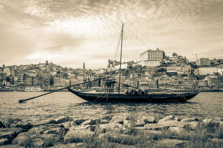 rabelo: Typical rabelo boat in Porto, Portugal. Photography processed in vintage style.