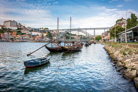 luis: Rabelos boats in Douro river near to the Luis I bridge, Porto, Portugal Editorial