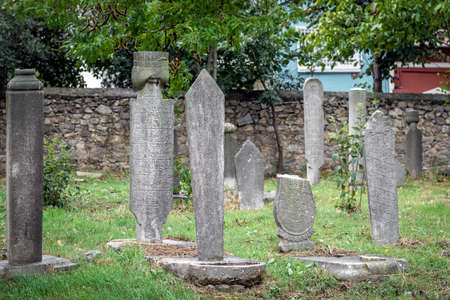 gravestones: ISTANBUL, TURKEY - September 30, 2015: Gravestones in the old  abandoned cemetery in Kadikoy in Istanbul, Turkey.