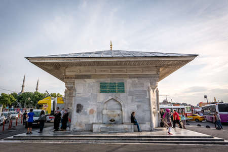 constantinople ancient: Istanbul, Turkey - June 27,2015: Local turkish people walking in Uskudar district next to the Fountain of Ahmed III skdar. Photography is taken in central area of Uskudar near bus stops and port.