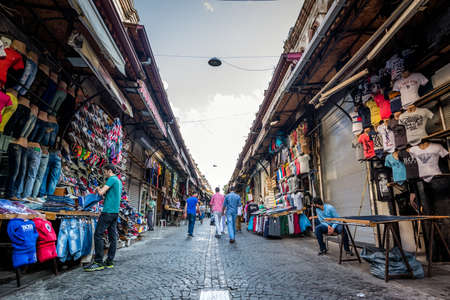 fatih: Istanbul, Turkey - July 07, 2015: People are shopping in the street market of Istanbul. Male clothing in the turkish market.