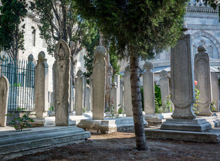 sufi: Istanbul, Turkey - July 07, 2015. Cemetery courtyard of famous Süleymaniye mosque in Istanbul. There are many historical headstones and graves.