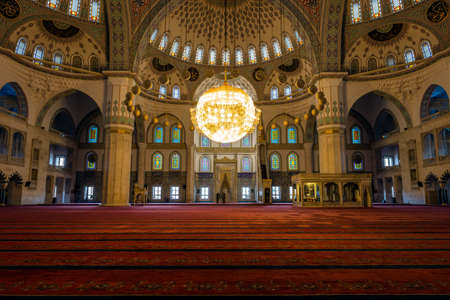 sunni: Ankara, Turkey - October 23, 2015: Kocatepe mosque interior in the evening. Every day local people and tourists are visiting the mosque and praying. Photography of slow shutter spead. Editorial