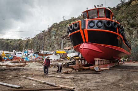 preperation: Rumelifeneri, Turkey - December 15, 2015: Men are working at the dock where they are doing preperation works for launching a new ship.