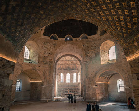 rotunda: Thessaloniki, Greece - December 24, 2015: Tourists are visiting Rotunda of Galerius. Its interior is decorated with Early Christian mosaics.