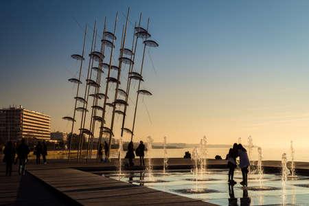 holdup: Thessaloniki, Greece - December 24, 2015: People are enjoying the sunny weather near seaside