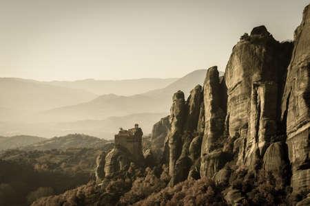 kalampaka: Green valley and Greek monasteries surrounded by dark cliffs, Meteora, Greece