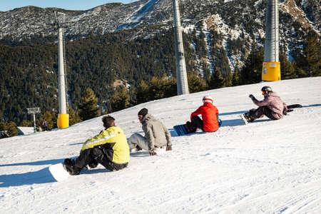 station ski: Bansko, Bulgaria - December 29, 2015: Snowboarders resting in ski resorts station up in the mountains.