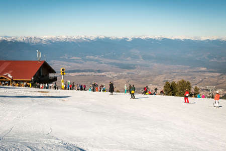 treck: Bansko, Bulgaria - December 29, 2015: Skiers skiing on a slope in the resort next to the  upper station