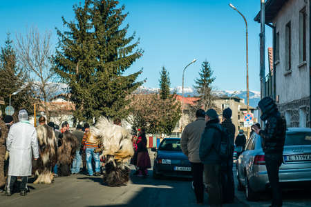 coming together: Bansko, Bulgaria - January 01, 2016: People are coming together to celebrate the custom festival of Mummers Kukeri in Bulgaria Editorial