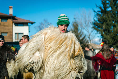 coming together: Bansko, Bulgaria - January 01, 2016: People are coming together to celebrate the custom festival of Mummers Kukeri at January in Bulgaria