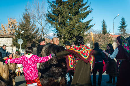 coming together: Bansko, Bulgaria - January 01, 2016: People are coming together for games and dances to celebrate the custom festival of Mummers Kukeri at January in Bulgaria Editorial