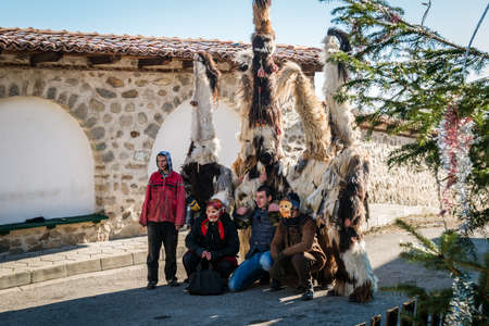 ethnographical: Dobarsko, Bulgaria - January 01, 2016: People are coming together for games and dances to celebrate the custom festival of Mummers Kukeri at January in Bulgaria