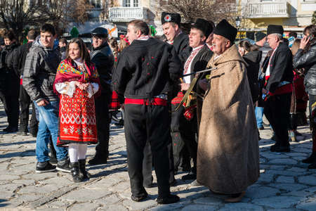 coming together: Razlog, Bulgaria - January 01, 2016: People are coming together for games and dances to celebrate the custom festival of Mummers Kukeri at January in Bulgaria