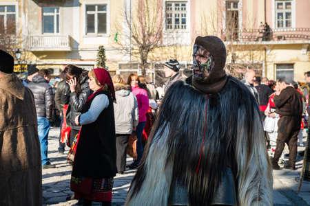 local festivals: Razlog, Bulgaria - January 01, 2016: Man in the mask came to celebrate the custom festival of Mummers Kukeri at January in Bulgaria