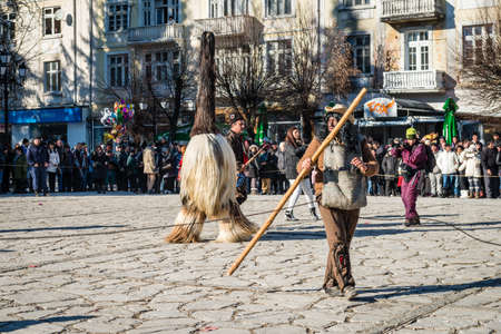 viewers: Razlog, Bulgaria - January 01, 2016: People in costumes are taking part in the festival of Mummers in Razlog, Bulgaria. Games, dances and activities are organized for viewers. Editorial