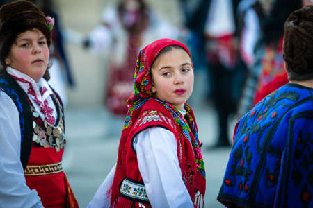bulgaria girl: Razlog, Bulgaria - January 01, 2016: Children in costumes are taking part in the festival of Mummers in Razlog, Bulgaria. Games, dances and activities are organized for viewers.