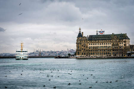 haydarpasa: Istanbul, Turkey - January 18, 2016: Ferry boat passing by Haydarpasa train station in Kadikoy, Istanbul