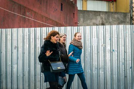very good: Istanbul, Turkey - January 31, 2016: Three ladies walking in a very good mood on the street in Istanbul, Turkey