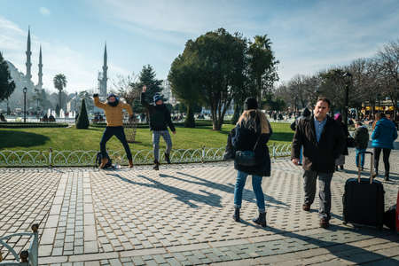 aya sofia: Istanbul, Turkey - January 31, 2016: Tourists are visiting Sultan Ahmet are and shooting funny photos in Istanbul, Turkey Editorial